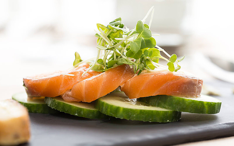 Salmon, cucumber and cress on a slate tray