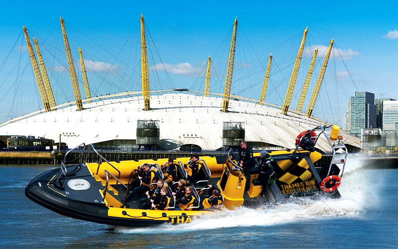 A RIB boat riding past The O2 Arena