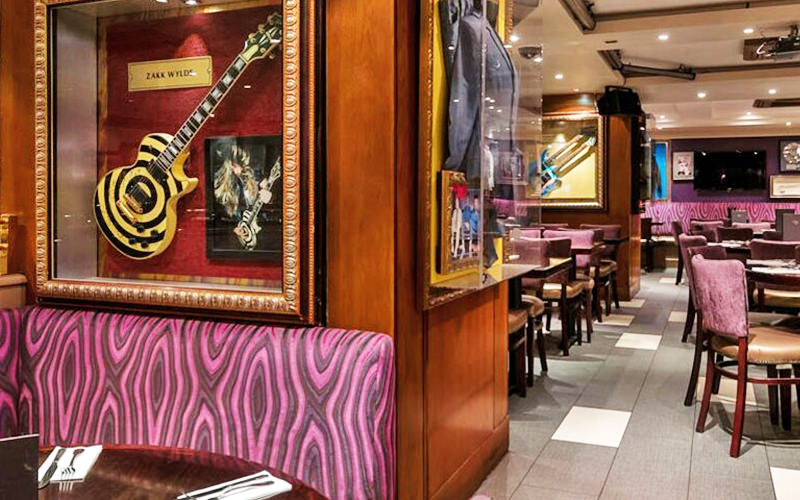 Pink chairs and tables in the restaurant area at Hard Rock Cafe, London