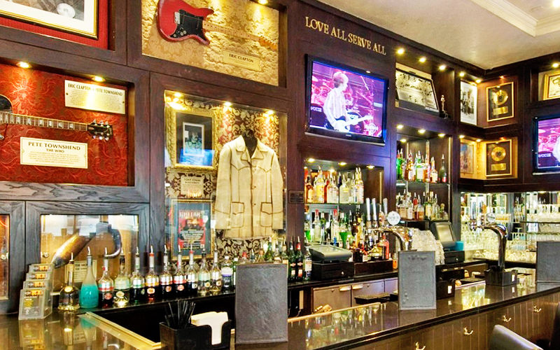 The bar, with music memorabillia behind, at the Hard Rock Cafe, London