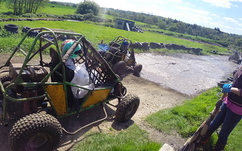 Buggies racing through mud