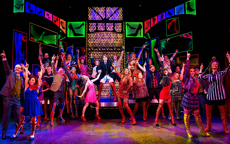 Cast of Kinky Boots taking part in a performance on stage.