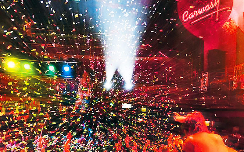 Confetti shooting out over a dance floor