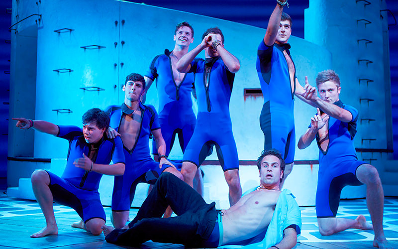 A group of men performing on stage at Mamma Mia the Musical