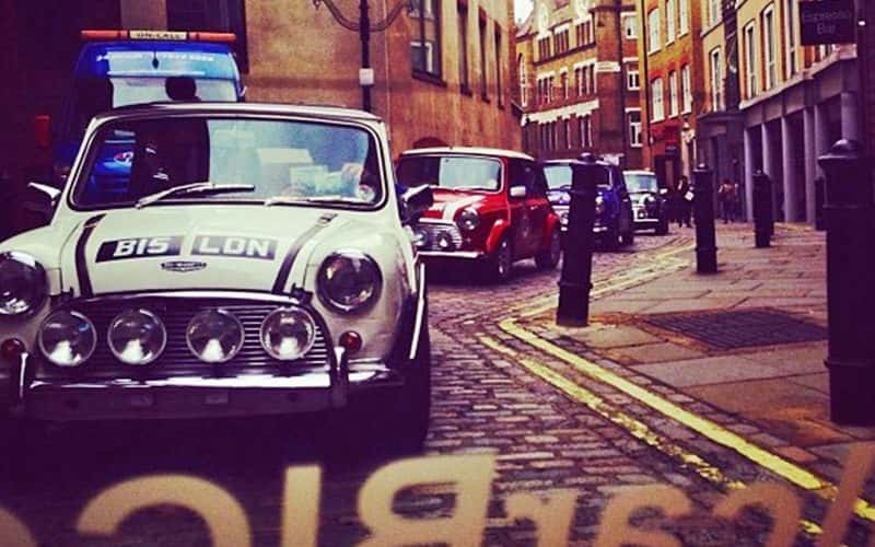 Mini Coopers in a cobbled street in London