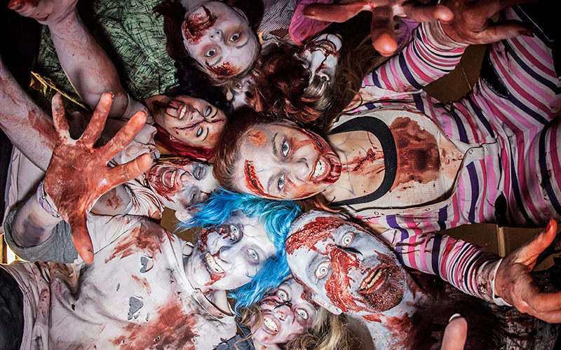 A group of people dressed as zombies looking down towards the camera