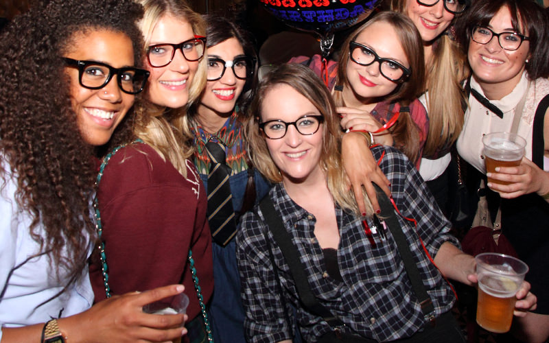 A group of girls dressed in nerd fancy dress on a night out