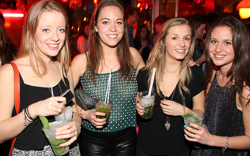 Four girls all with mojitos on a night out
