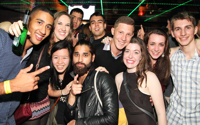 A group photograph of men and women in a club