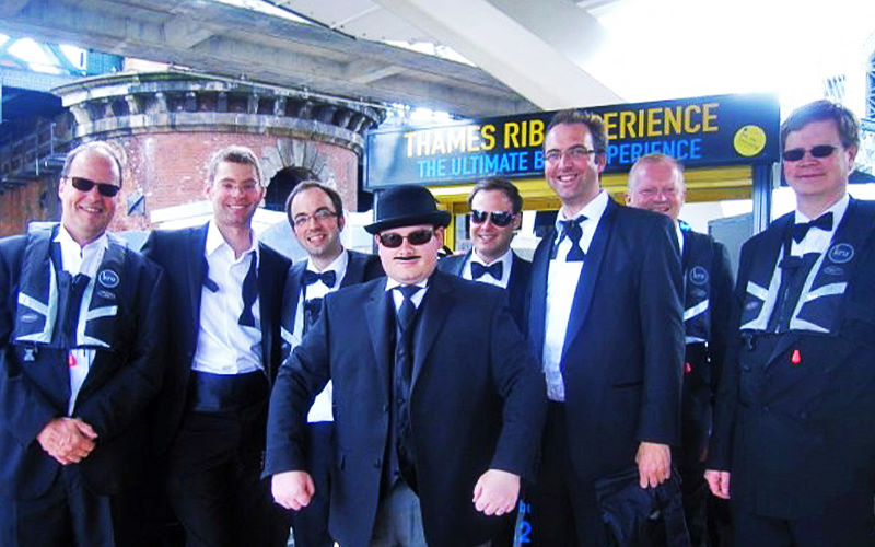 A group of men in black suits and bowties
