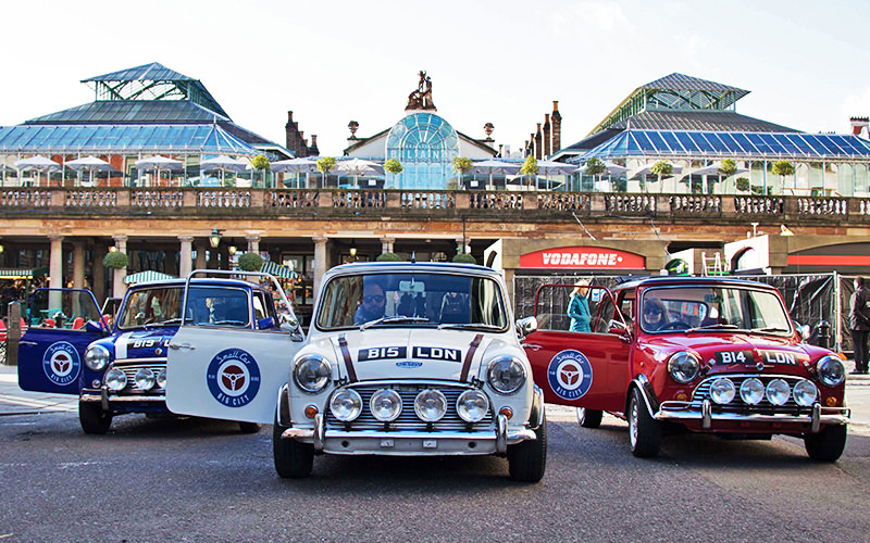 Three Mini Coopers with their driver doors open