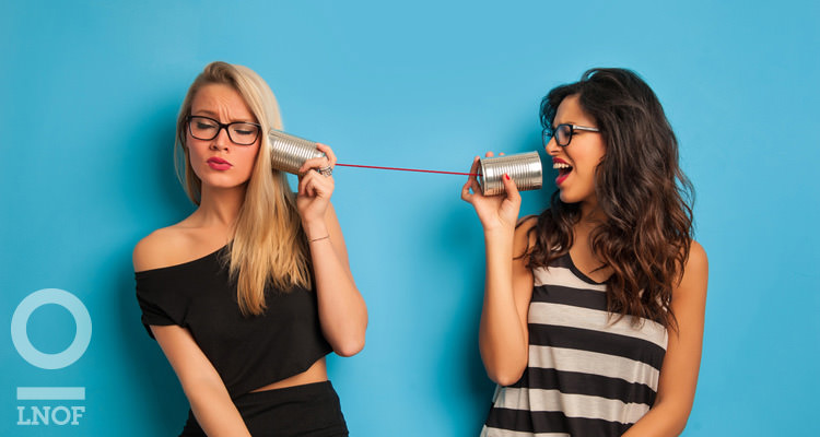 Women talking on a string phone