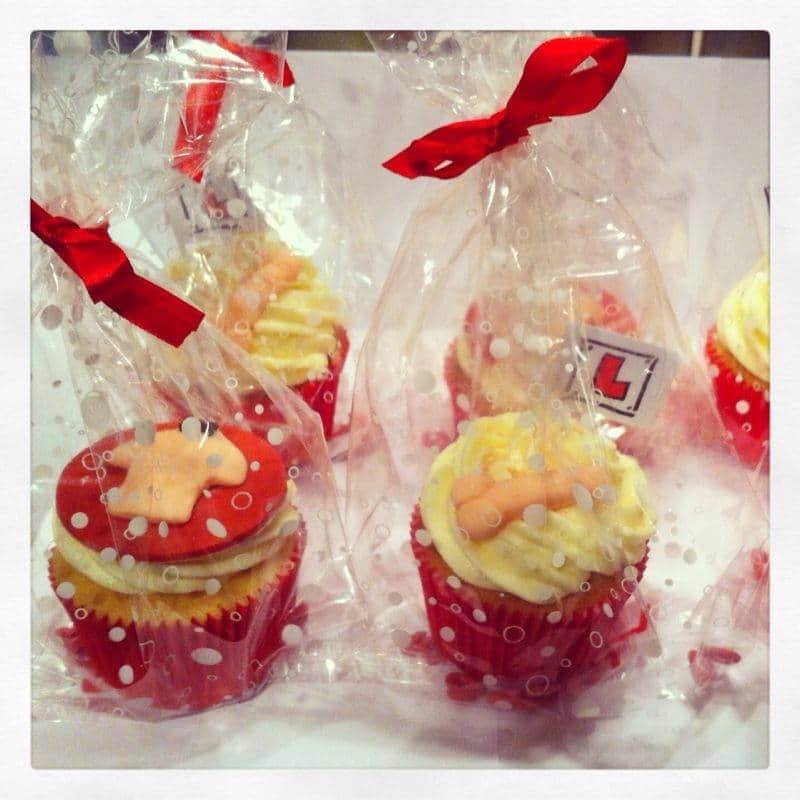 Naughty hen party cupcakes in transparent bags, tied up with red ribbon