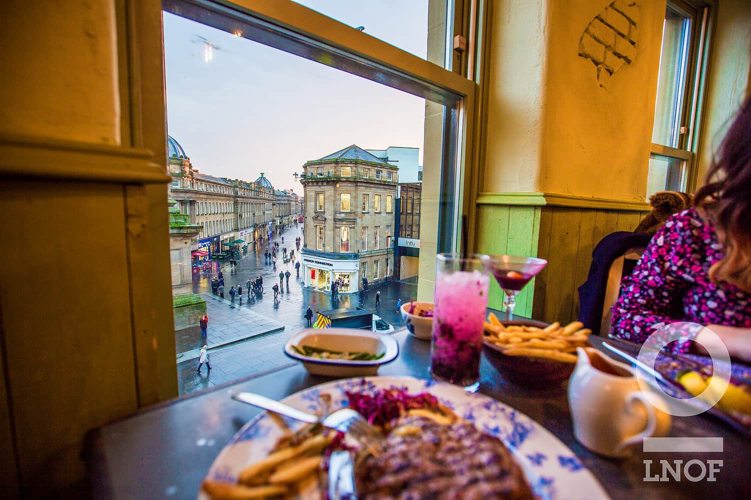 Dining room overlooking Grey's Monument at The Botanist in Newcastle