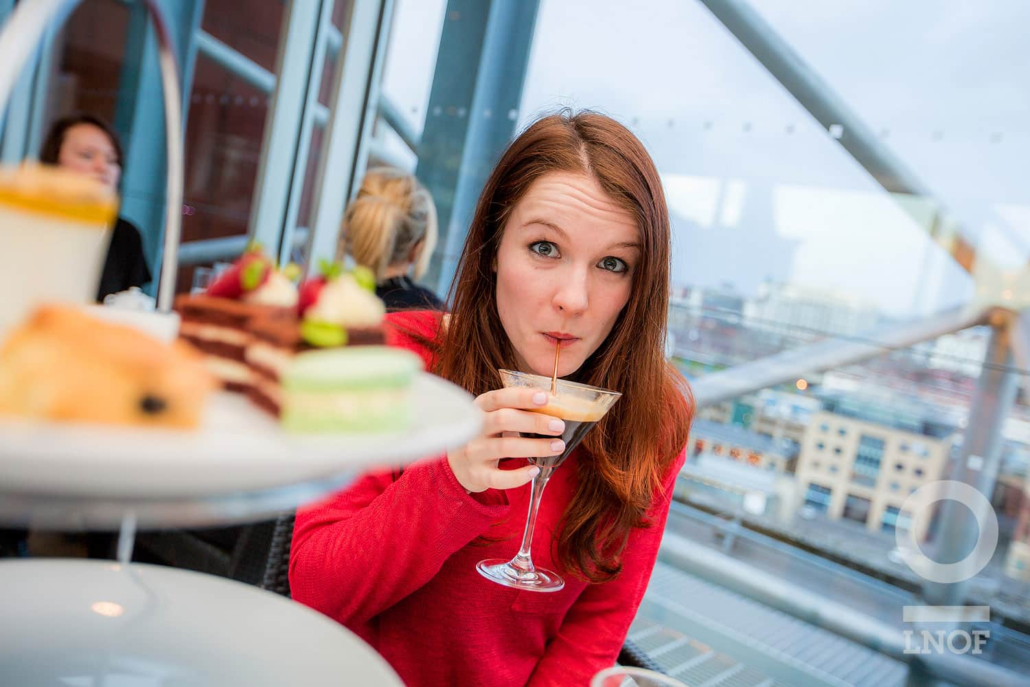 Woman drinking an espresso martini