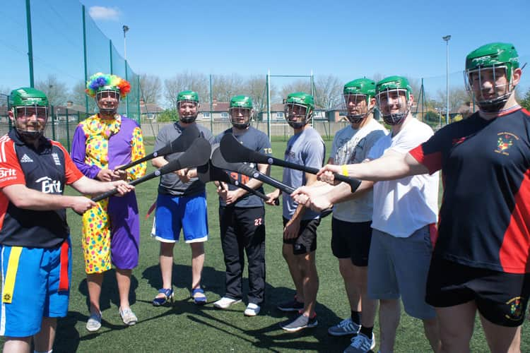 Stag group with hurling sticks for the Gaelic Games