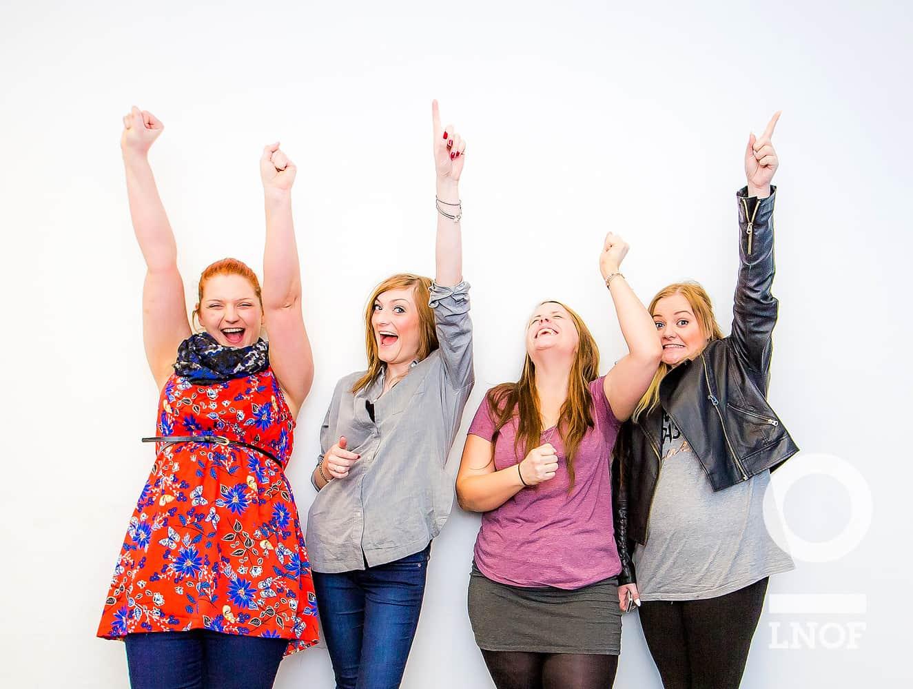 Happy women punching the air