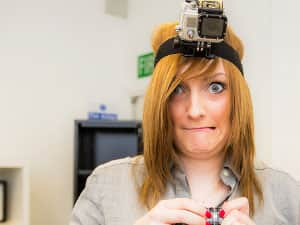 Confused woman wearing a Go Pro