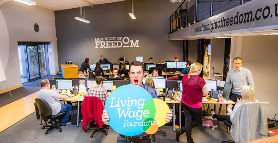 Managing Director of Last Night of Freedom, Matt Mavir, holding the Living Wage sign