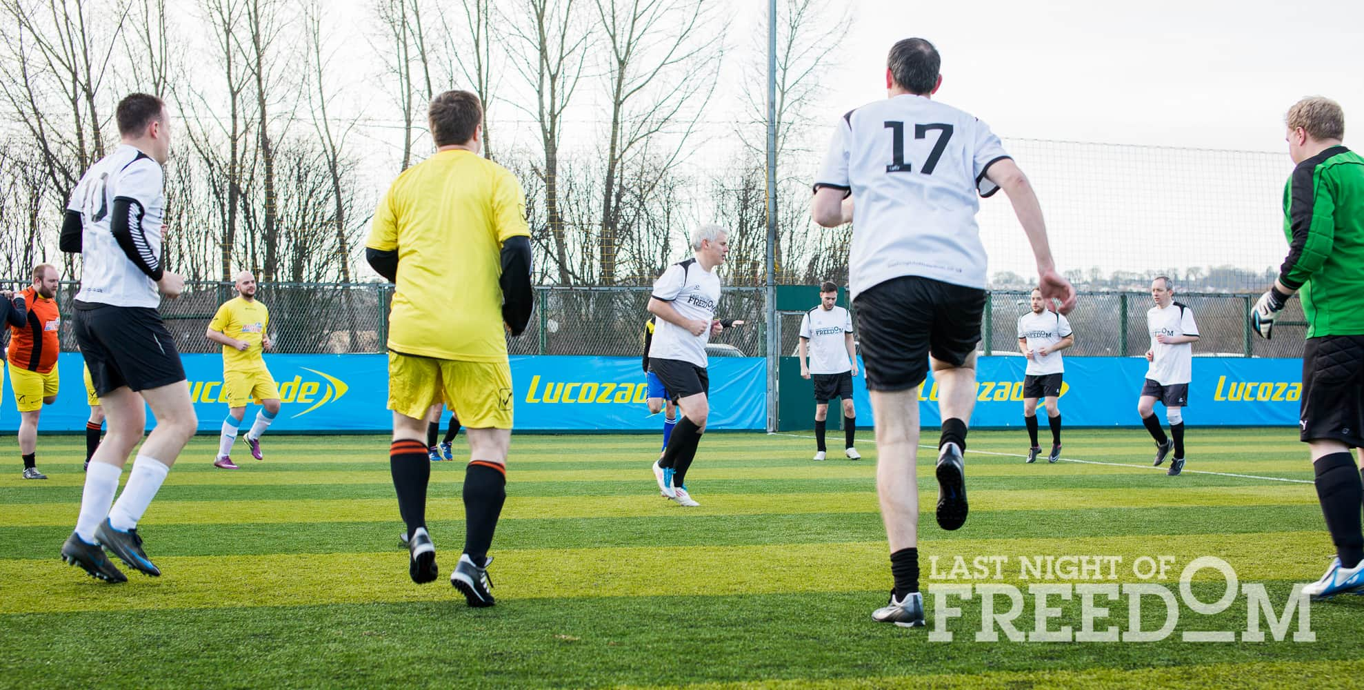 Rob Lee leading players in a warm up on the pitch