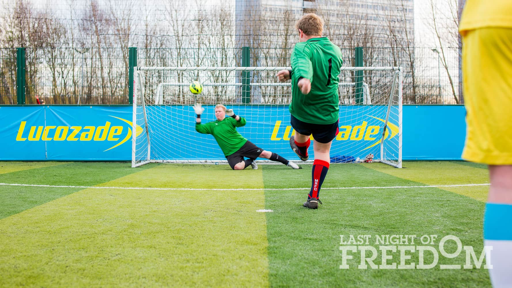 Sales team member Adam scores a penalty against rival goalkeeper Joe.
