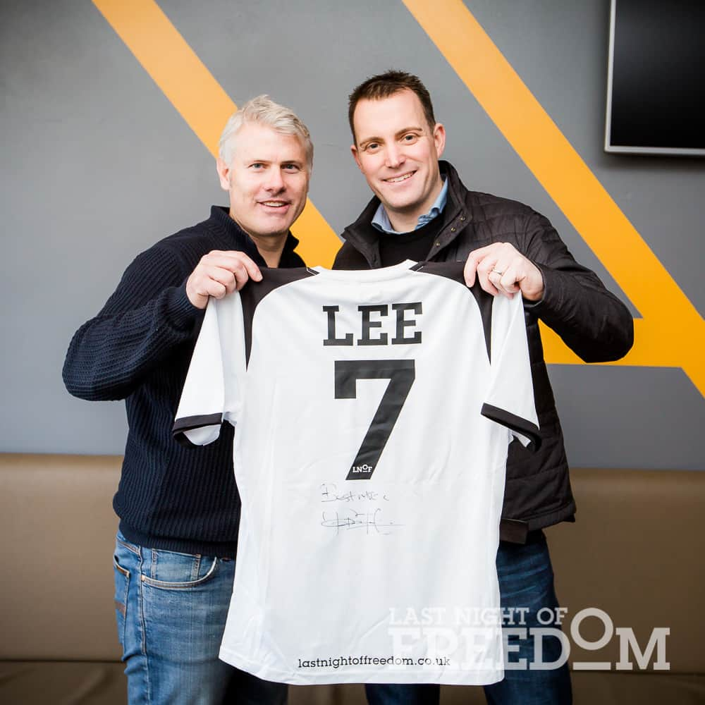 Rob Lee presents signed Last Night of Freedom shirt to Managing Director Matt Mavir