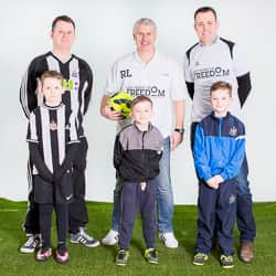 Rob Lee poses for photograph with adults and kids