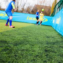 Players taking part in Play with a Legend clearing the ball down the line