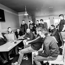 Group of lads listening to Rob Lee talk about his footballing past
