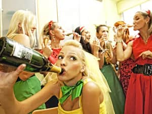 Woman drinking champagne with her friends