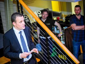A man making a speech on a set of stairs