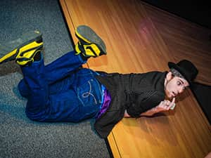 A man lying on the floor and posing