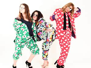 Three women posing in Opposuits