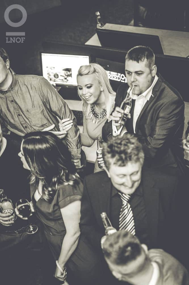 Black and white image of people at a housewarming party