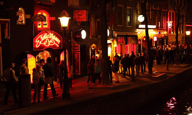 People walking down the street in the Red Light District, Amsterdam, at night