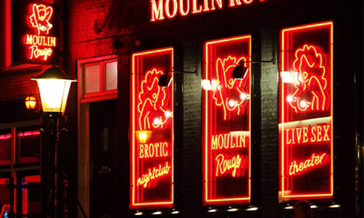 Close up of the lit-up red signs at Moulin Rouge, Amsterdam