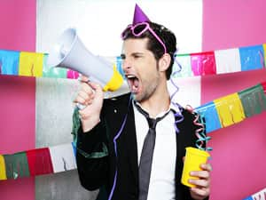 Man shouting into a megaphone whilst holding a yellow cup