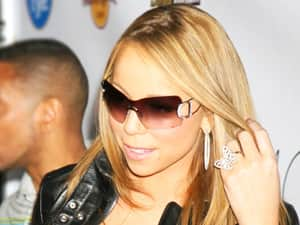 Mariah Carey in sunglasses holding her hair