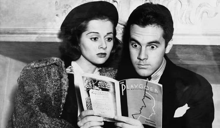 Vintage couple reading a shocking magazine
