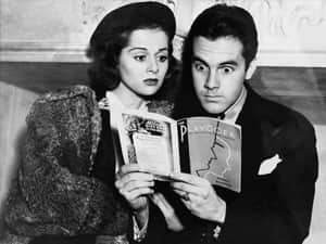Man and women reading a book in black and white