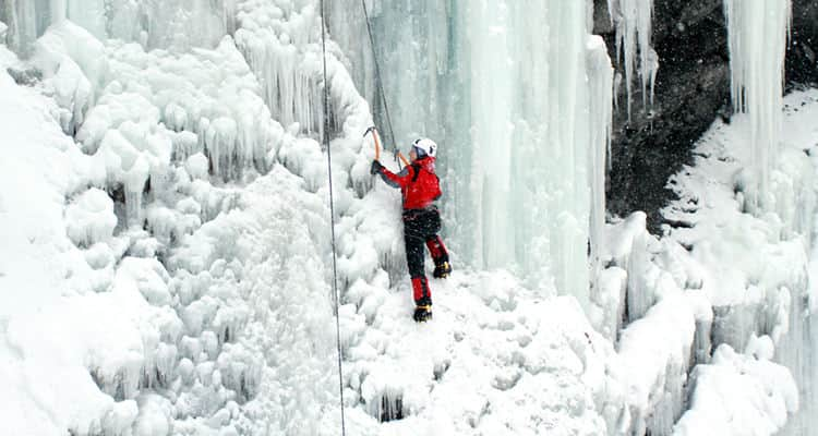 A man climbing a wall of ice
