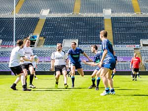 LNOF staff playing a game of rugby at St James' Park
