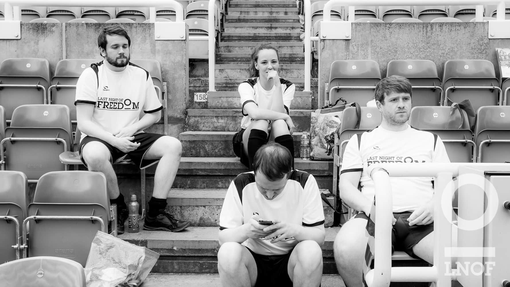 LNOF staff sat down and waiting to play rugby