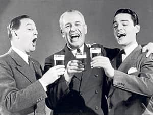 black and white retro photo of three men in suits