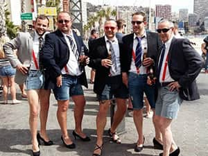 A group of men dressed up for a stag do