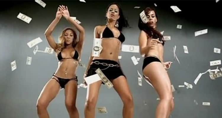 Three female strippers dancing in dollar bills