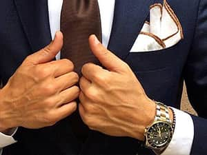 Close up of suave suit and tie and expensive watch