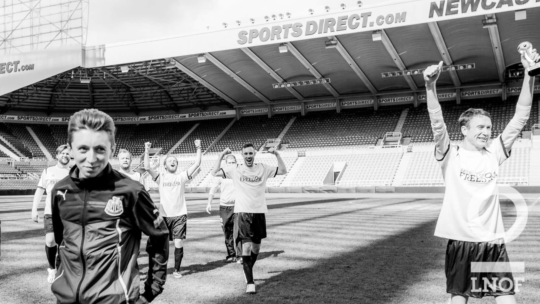 Footballers walking off the pitch at St James' Park