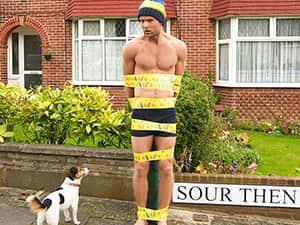 man taped to lamppost