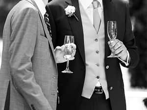 An image of two men at a wedding holding champagne flutes